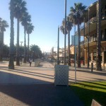 Picturesque Glenelg. Another view of Mosely Square., looking at it from beachside. Jetty Road, Glenelg's high street, is in the background. On the right is The Grand, straight ahead is where the trams dock, to the left is another memorial commemorating the proclamation of South Australia